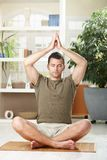 Man doing yoga exercise Stock Image