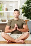 Man doing yoga exercise Stock Images