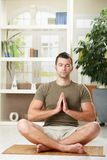 Man doing yoga exercise Stock Photo