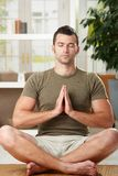 Man doing yoga exercise Royalty Free Stock Image
