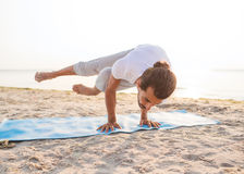 Man doing yoga exercises outdoors Royalty Free Stock Image