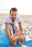 Man doing yoga exercises outdoors Stock Photography