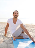 Man doing yoga exercises outdoors Royalty Free Stock Photo