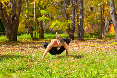 Man doing yoga in forest Royalty Free Stock Photos