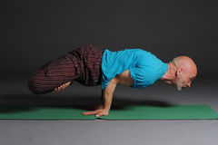 Man doing yoga Stock Images