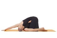 Man doing yoga, isolated on white background Royalty Free Stock Image