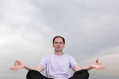 Man doing yoga Stock Photos