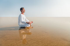 Man doing yoga meditation in Lotus position Royalty Free Stock Image