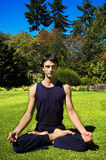 Man doing yoga in nature. Royalty Free Stock Photography
