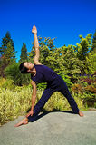 Man doing yoga in nature. Royalty Free Stock Images