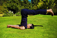 Man doing yoga in nature. Royalty Free Stock Photos