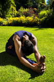 Man doing yoga in nature. Stock Image