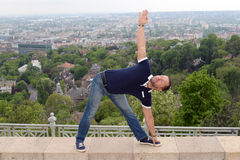 Man doing yoga in nature Stock Photo