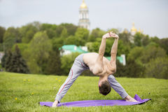 Man doing yoga in nature Royalty Free Stock Image
