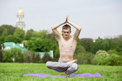 Man doing yoga in nature Stock Photography