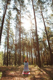 Man doing yoga in the pine forest Stock Photos