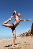 Man doing yoga pose king of dances Stock Photos