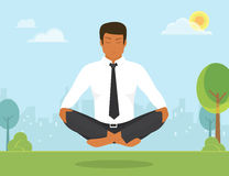 Man is doing yoga and sitting in the lotus Royalty Free Stock Photos