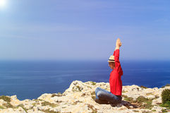 Man doing yoga in summer mountains Royalty Free Stock Images