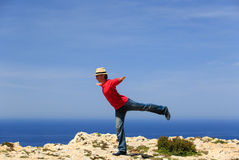 Man doing yoga in summer mountains Stock Images