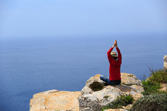 Man doing yoga in summer mountains Royalty Free Stock Image