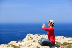 Man doing yoga in summer mountains Stock Photos