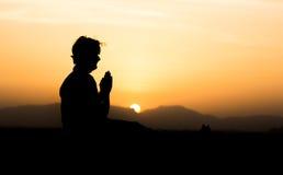 Man doing yoga at sunset point Stock Image