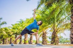 Man doing yoga in a tropical park stock photos