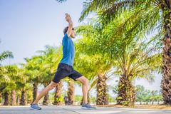 Man doing yoga in a tropical park stock photography