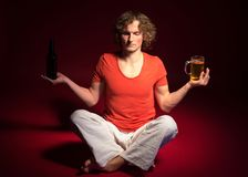 Man Doing Yoga With Beer Stock Images