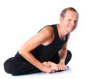 Man doing yoga Stock Photos