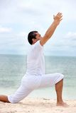 Man doing youga exercises Stock Photo