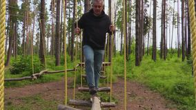 Man doing zip line activity. In summer day stock footage