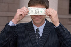 Man with dollar bill Royalty Free Stock Photo