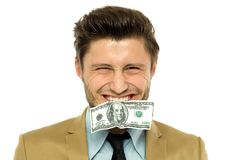 Man with a dollar-bill in his mouth Stock Image