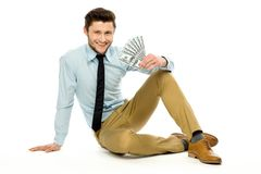 Man with dollar bills Stock Images