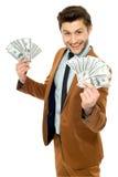 Man with dollar bills Royalty Free Stock Image