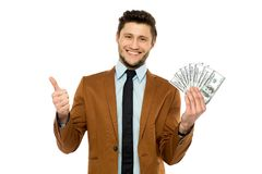 Man with dollar bills showing thumbs up Stock Photo