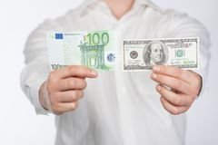 Man with dollar and euro Royalty Free Stock Photography