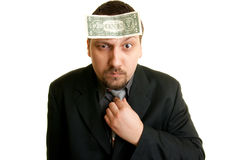 Man with a dollar on the forehead. Looks confused Stock Photo