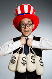 The man with dollar money sacks Royalty Free Stock Images