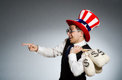 The man with dollar money sacks Stock Photo