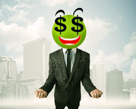 Man with dollar sign smiley face Stock Photo