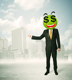 Man with dollar sign smiley face Stock Image