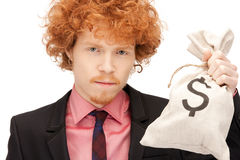 Man with dollar signed bag Stock Images