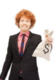 Man with dollar signed bag Stock Photo