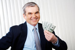 Man with dollars Stock Images