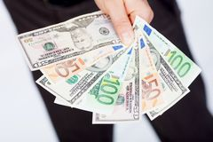 Man with dollars and euro Stock Photo