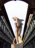 Man with dolphin, Clock Tower of Palazzo Vecchio and Uffizi Gallery, Florence, Italy Royalty Free Stock Image