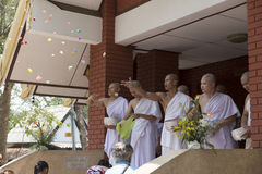 Man donate money for people in buddhist monk ordination ceremony Royalty Free Stock Photo